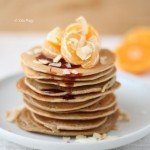 Vegan Coconut Oat Pancakes with Date Syrup, Coconut Chips and Clementine